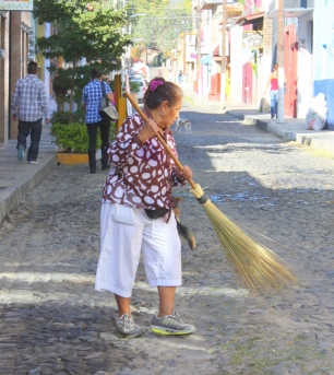 Sweeping the street on the parade route