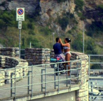 Lovers play in Porto Venere, Italy