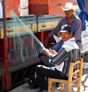 Weaving a fishing net on the plaza, San Cristóbal Zapotitlán