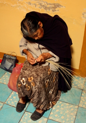 A vieja labors over her craftwork in San Cristóbal Zapotitlán