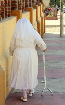 A sister with walker on a sidewalk in San Juan Cosalá