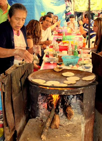 Made-from-scratch tortillas on a wood-fired, clay comal