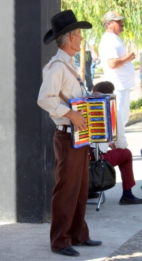 A musician plays for the crowd on Cajititlan's malecon