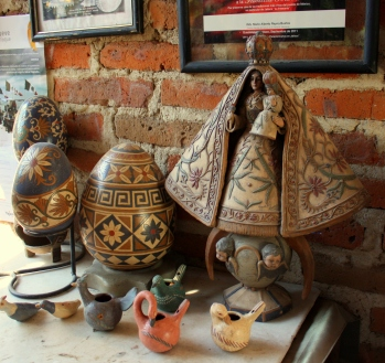 Egg-shaped globes, clay virgin, and clay whistles
