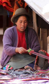 Native artisan weaving on a simple belt loom
