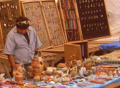 Jewelry vendor at the artisan market, Pisac, Peru