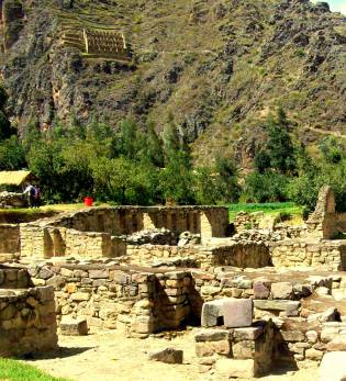Main ruins in foreground, Inca granary in background on mountain.
