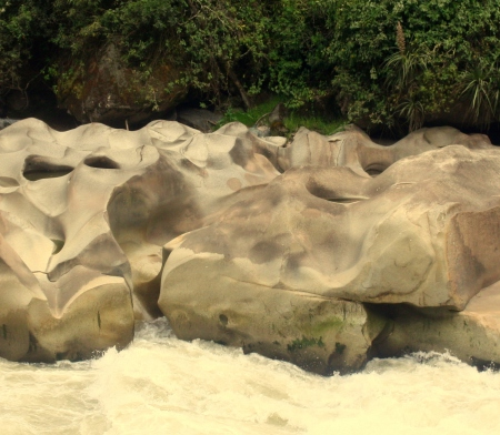Boulders worn smooth by rainy season current.