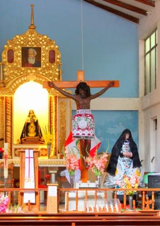 A dark-skinned Christ wears an Inca robe.