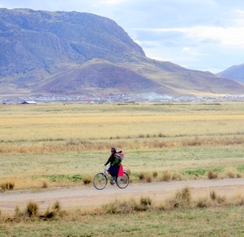 Bicyclist alongside the tracks of the Andean Explorer