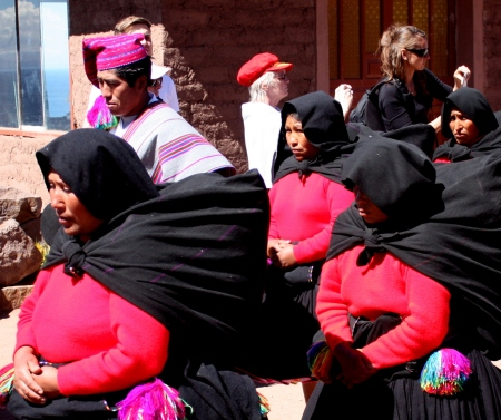 Identically dressed women join the procession