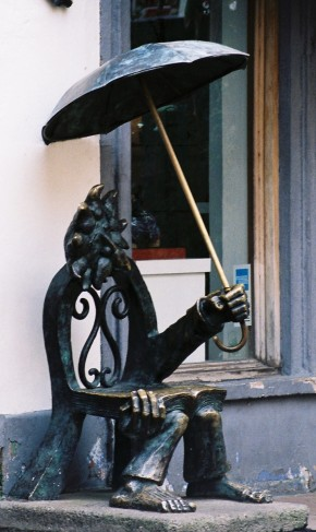 A bookworm metal sculpture awaits the rainy season.