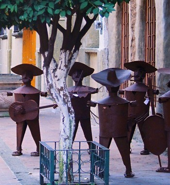 Sculpted metal mariachis silently serenade