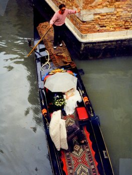 Bride and groom on gondola, Venice