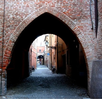 Gothic arch at the entry to one of the old city's streets, Ferrara, Italy