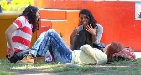 Student relaxing in Guadalajara's Parque Revolución.
