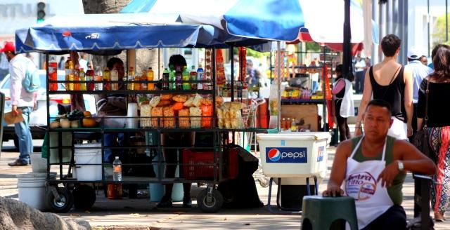 Taco stands about in Guadalajara's Parque Revolución.
