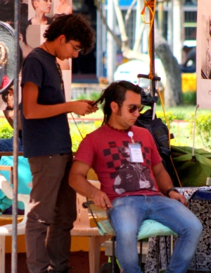 Getting a haircut in Guadalajara's Parque Revolución.