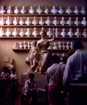 Homework sits in a sculpting workshop, FLorence, Italy.