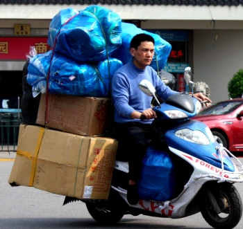The improbably large load is a common sight in Chinese cities.