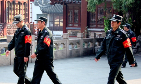 Police offers stroll through Old Shanghai.