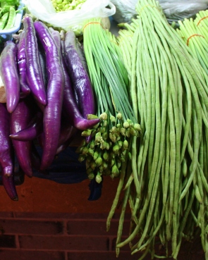 "Chinese eggplant and ""long beans"" dwarf their Western cousins."