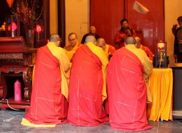 Elders deep in meditative prayer.