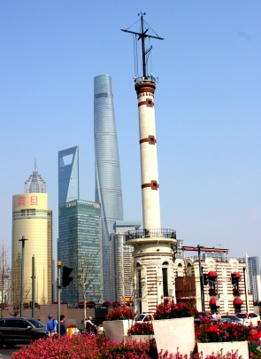 The Bund's old metereological tower (foreground) with Pudong Financial District (background) across the river.