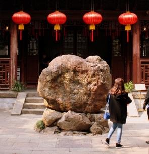 Walking through the entrance gate of Yu Garden.