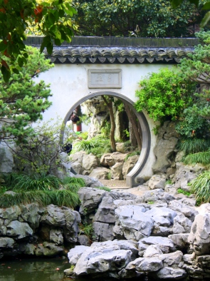 "A ""Moon Gate"" passage between landscape tableaus, Yu Garden, Shanghai."